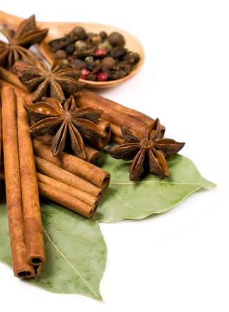 cinnamon sticks , bay leaf and star anise on white background
