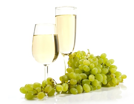 two glasses of white wine and grapes isolated 写真素材