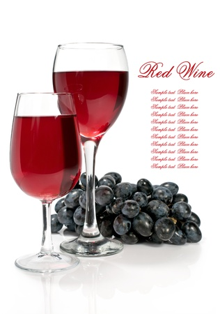 red wine with grapes on a white background photo