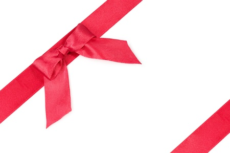 red silk ribbon with a bow on white Stock Photo - 15842303