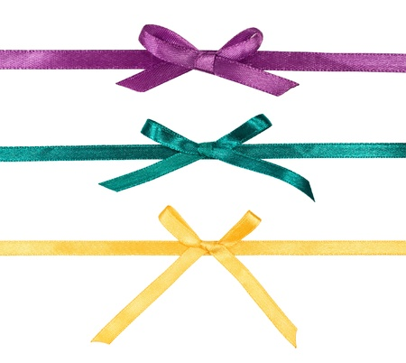 yellow ribbon: colorful silk ribbons with bows on white