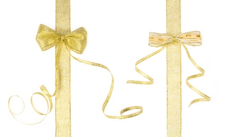 organza: two golden ribbons with bows isolated on white Stock Photo