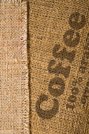 background with texture of burlap and the word  coffee