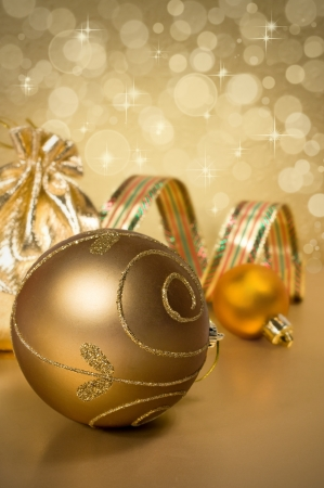 golden Christmas balls and ribbon on a background with lights Stock Photo - 16263694