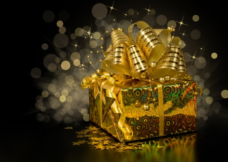 golden gift box with confetti in the shape of stars on a dark background with lights photo