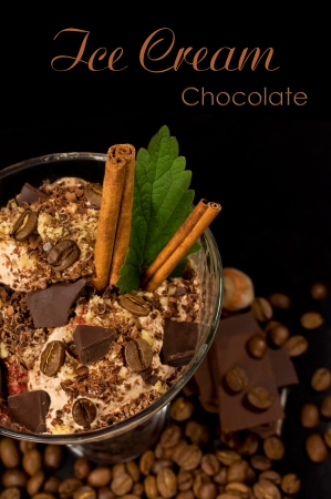 coffee ice cream with chocolate, coffee beans , mint and cinnamon sticks photo