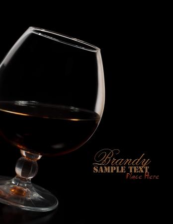 glass of brandy on a black background Stock Photo - 16954247