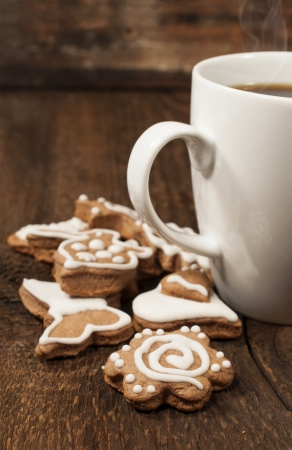 teaparty: memade cookies with a cup of coffee on a wooden background