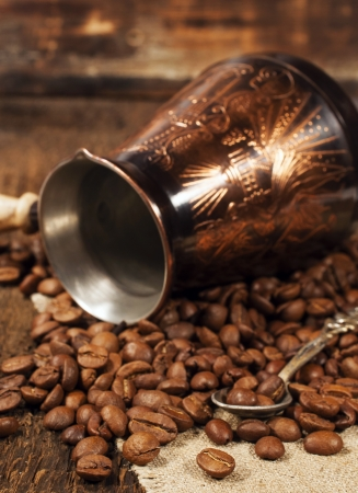 cezve: Copper Turk and coffee beans close-up