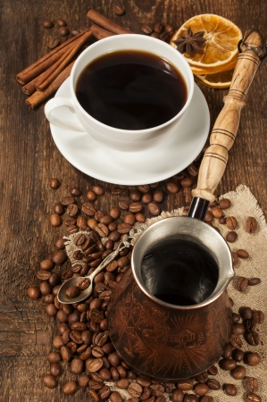 cezve: Coffee still life with copper Turku, cup and coffee beans  Stock Photo