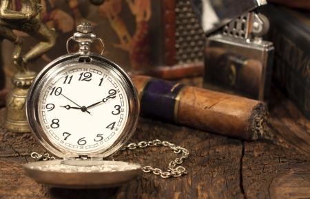 still life with vintage pocket watch