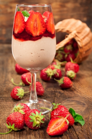strawberry dessert with mousse and fresh berries on the wooden background
