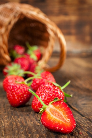 ripe strawberry on a wooden background photo