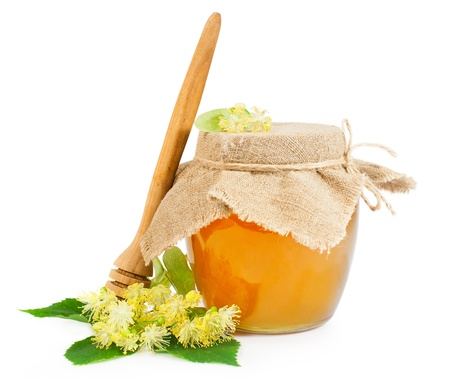 Sweet honey with linden blossoms isolated on white Stock Photo