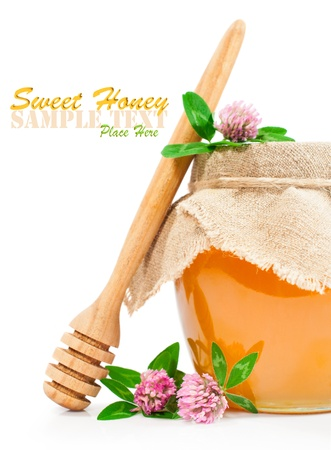 Sweet honey in a glass jar with clover photo