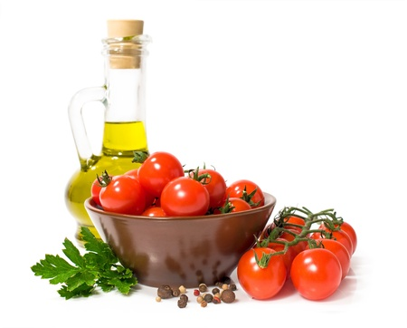 cherry tomatoes with olive oil and spices isolated on white Stock Photo