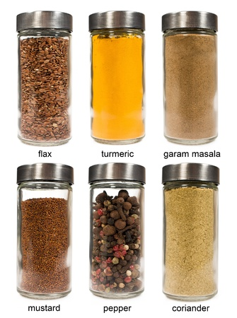 set of spices in glass jars isolated on white photo