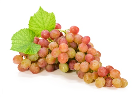 fresh bunch of grapes with leaves isolated on white photo
