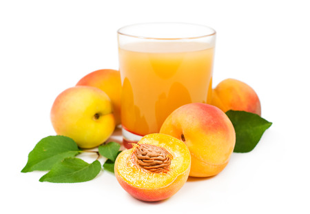 peach juice with fresh fruits isolated on white background