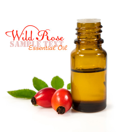 bottle of essential oil of rose hips isolated on white