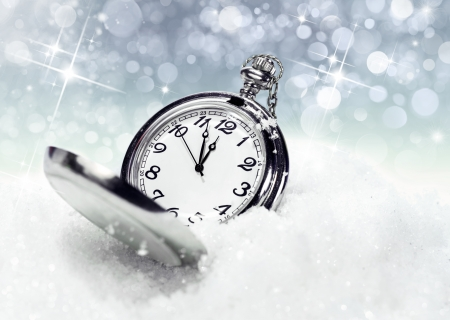 New Years backgrounds .pocket watch in the snow photo