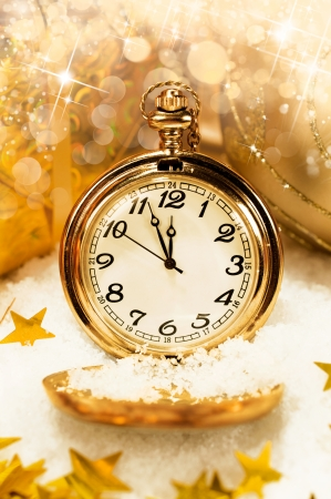 New Year background. pocket watch showing five minutes to midnight. photo