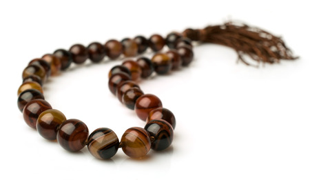 carnelian: Rosary of carnelian beads isolated on white