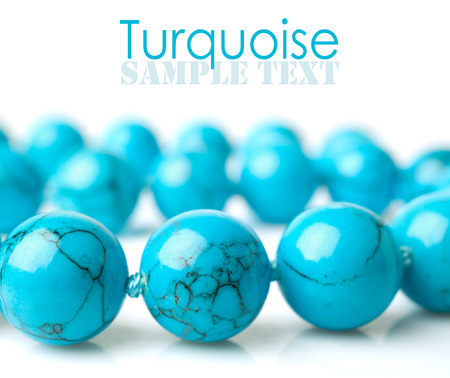 thread turquoise beads close-up isolated on white
