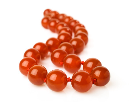 Carnelian necklace isolated on white