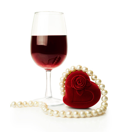 glass of red wine with pearl isolated on white photo