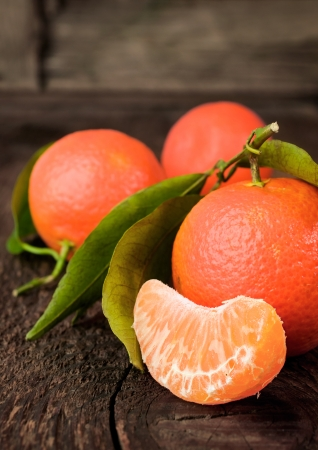 Ripe mandarin on a wooden background  Stock Photo