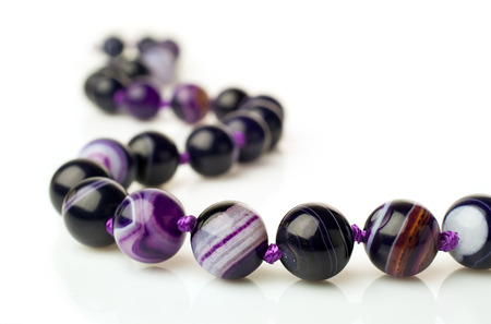 nicety: purple agate necklace isolated on white Stock Photo