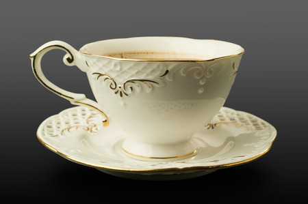 fine porcelain cup and saucer on a black background