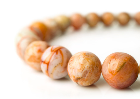 nicety: agate beads closeup isolated on white Stock Photo