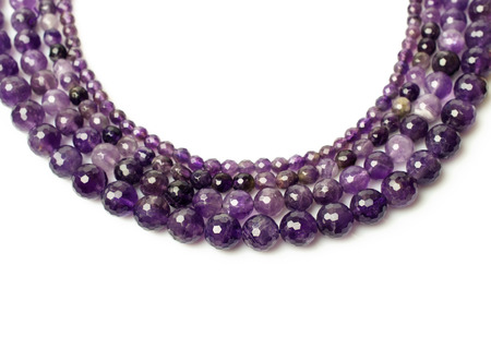 amethyst necklace isolated on white photo