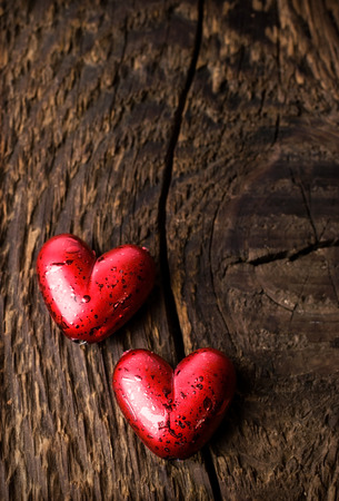 Decorative red hearts on a wooden background photo