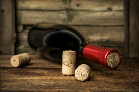 bottle of red wine with corks photo