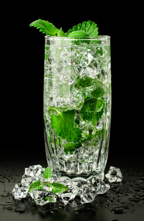 mojito in a tall glass on a black background