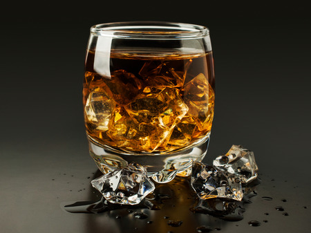 whiskey with ice on a black background photo