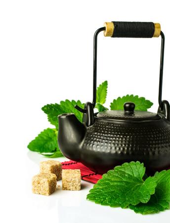 Closeup of tea set on white background  photo