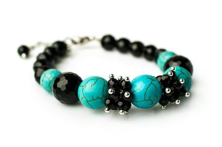 black onyx: bracelet of turquoise and black onyx isolated on white