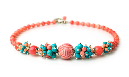 lovely necklace of coral and turquoise isolated on white photo