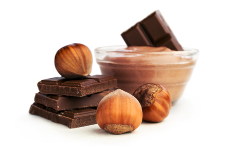 nut butter and chocolate with hazelnuts isolated on white
