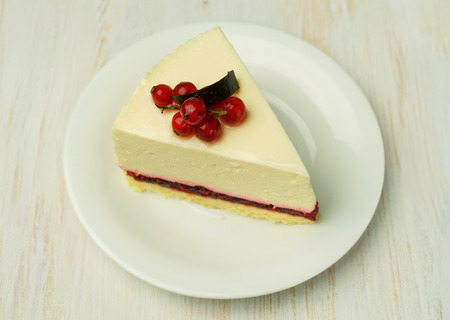 currant: cheesecake with red currant close-up