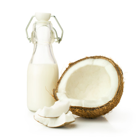 coconut and milk in a glass bottle isolated on white 写真素材