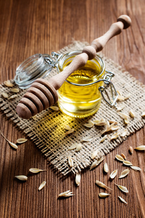 stile: Honey in rustic stile on wooden table