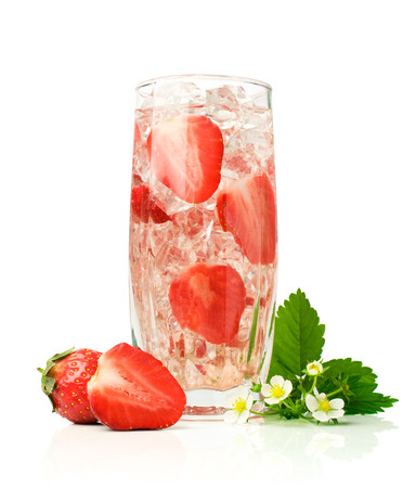 refreshment: Refreshment beverage with strawberries and ice cubies isolated on white
