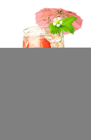 Strawberry cocktail with fresh berries and umbrella isolated on white