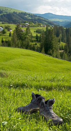 trekking boots on the background of the mountains