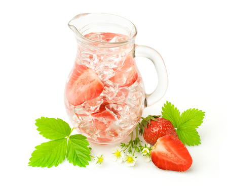 Refreshments: Refreshment beverage with strawberries and ice cubies isolated on white